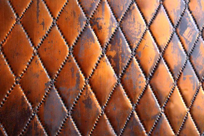 Foto Ornament Hintergrund aus Leder braun gold